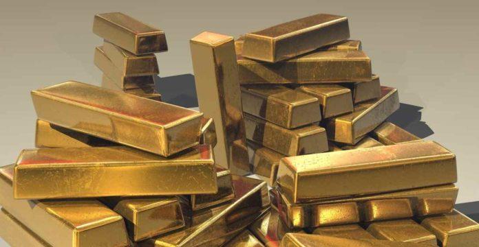penyebab harga emas naik