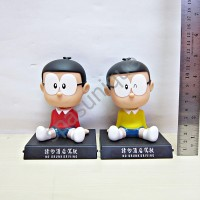 pajangan mobil kepala goyang karakter boneka Nobita