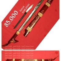 Mandau ukir naga timbul, senjata khas Kalimantan