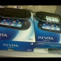 psp vita wifi 3g + memory 16gb + 1 cd gamw