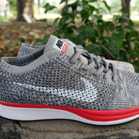 nike flyknit racer no parking grey red