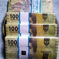 uang kertas Rp 1000 cut mutia