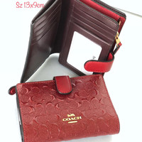 coach embos wallet red