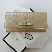 2656744830a234 Dompet gucci original - Gucci bow long wallet gold beige