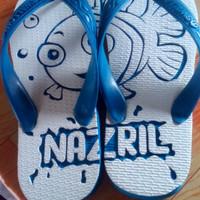 sandal jepit ukir motif n nama
