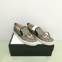 Gucci angry cat slip on
