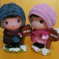 Boneka celengan sepasang