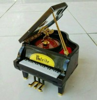 kotak musik piano kado ultah