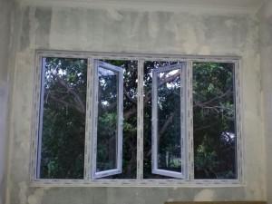 jendela rumah - jendela swing - jendela double swing UPVC