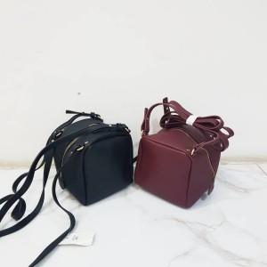 Cubical leather sling bag