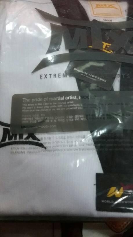 Foto Produk DOBOK (BAJU TAEKWONDO) MTX RIBBED DAN. DESAIN BY MOOTO (KOREA SELATAN) dari Tama Taekwondo Sport