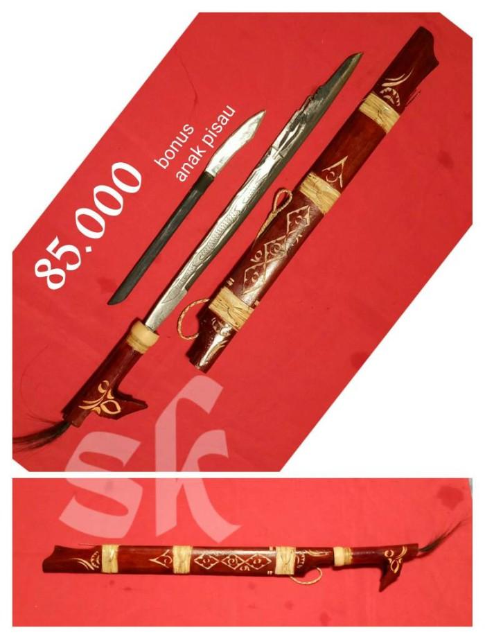 harga Mandau motif naga timbul, senjata khas dayak kalimantan Tokopedia.com