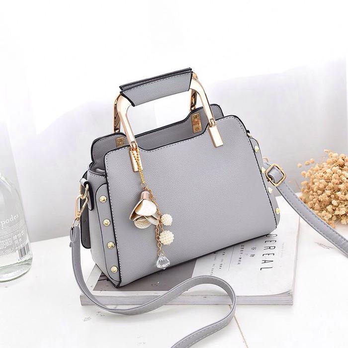 ... harga Esb8767 tas import handbag pearl diamond metal flower  Tokopedia.com. Rp. 130000 3a51dbcaa5