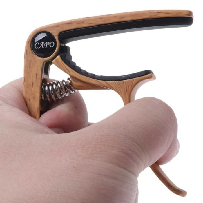 harga Capo untuk gitar aluminum alloy desain kayu with bridge pin remover Tokopedia.com