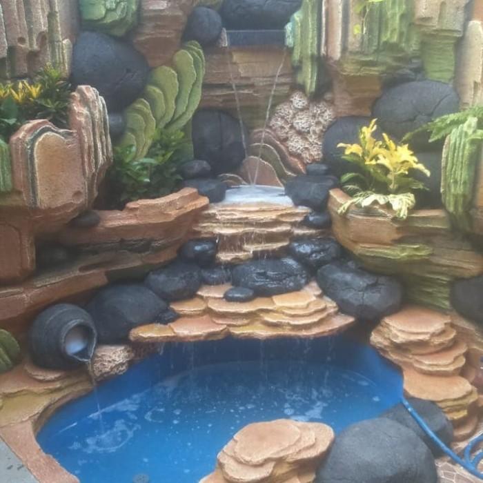 taman hias kolam tebing relief