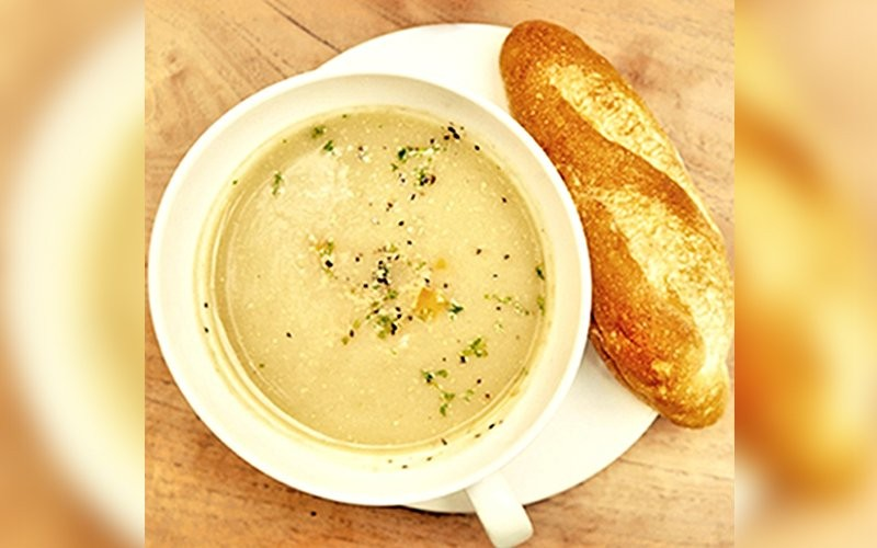 Cauliflower Soup: Roasted Cauliflower Garlic + Parsley + Basil + Matured Cheddar Home-Made Croutons + Caramelized Onion - Dine in